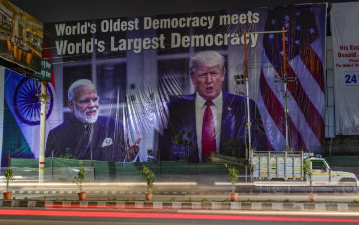 A view of a hoarding with images of Prime Minister Narendra Modi and US President Donald Trump, ahead of Trump's maiden visit to India, in Agra, Saturday, Feb. 22, 2020. Credit: PTI Photo