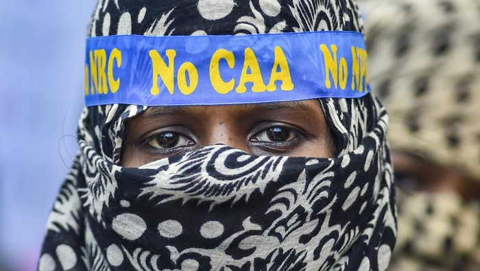 A muslim woman looks on during a protest against CAA, NRC, NPR, in Chennai. (PTI Photo)