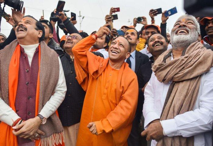 UP Chief Minister Yogi Adityanath flies a kite on the auspicious day of 'Basant Panchami' during Ganga Yatra, in Prayagraj