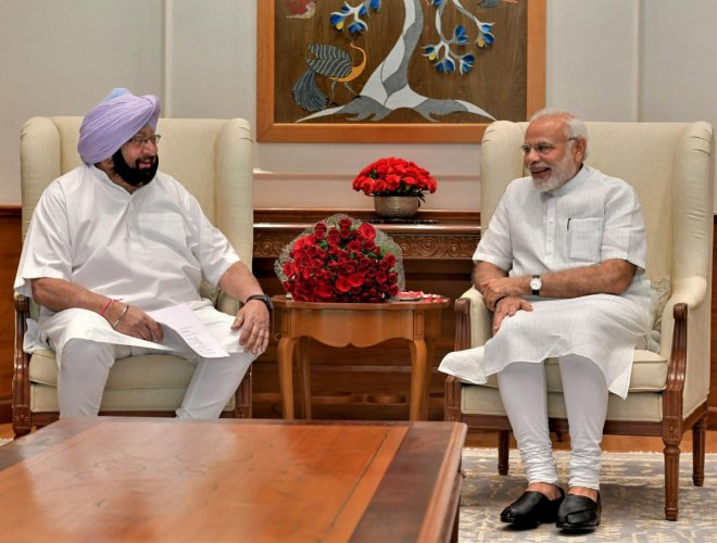 Prime Minister Narendra Modi with Punjab Chief Minister Amarinder Singh, in New Delhi on Monday, June 18, 2018. (PTI Photo)