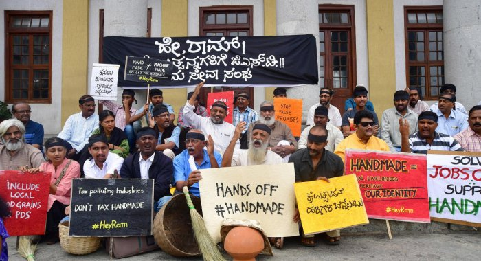 Members of the Grama Seva Sangh, led by theatre personality Prasanna, stage a protest at Town Hall Circle on Sunday, demanding zero GST on all handmade goods. DH PHOTO/ANAND Bakshi