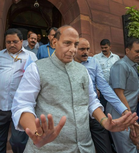 Home Minister Rajnath Singh leaves during the Monsoon Session of Parliament, in New Delhi on Monday, July 23, 2018. PTI Photo