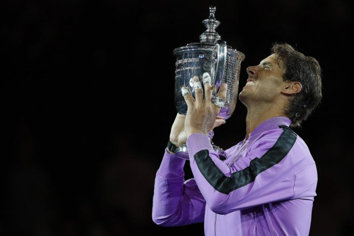 Rafael Nadal of Spain celebrates with the championship trophy after winning Grand slam title in U.S. Open. (Image USA TODAY Sports)