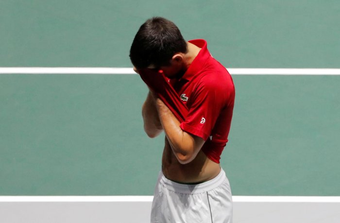 Serbia's Novak Djokovic reacts after losing his doubles match against Russia's Andrey Rublev and Karen Khachanov. (Reuters Photo)