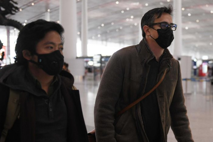Two Wall Street Journal reporters left China on February 24 after being expelled over a controversial headline in an op-ed that angered Beijing. (AFP Photo)