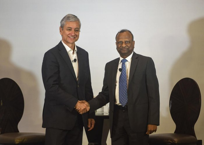 EVP and President, Global Sales, Marketing & Operations, Microsoft Corporation, Jean-Philippe Courtois (L), shakes hands with Chairman SBI Rajnish Kumar (R), during a press conference to launch Microsoft - SBI foundation collaboration to create opportunities for India, in Mumbai, Monday, Feb. 24, 2020. (PTI Photo)