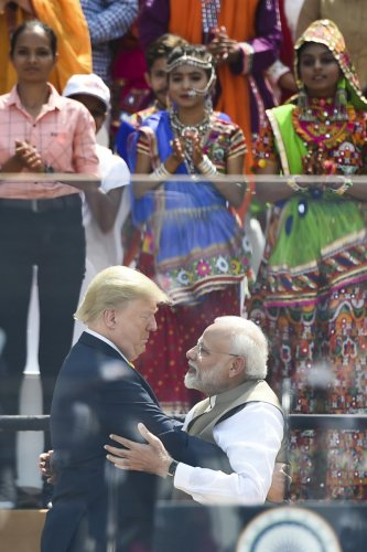 US President Donald Trump (L) embraces Prime Minister Narendra Modi during 'Namaste Trump Rally' at Sardar Patel Stadium in Motera, on the outskirts of Ahmedabad, on February 24, 2020. (Photo by AFP)