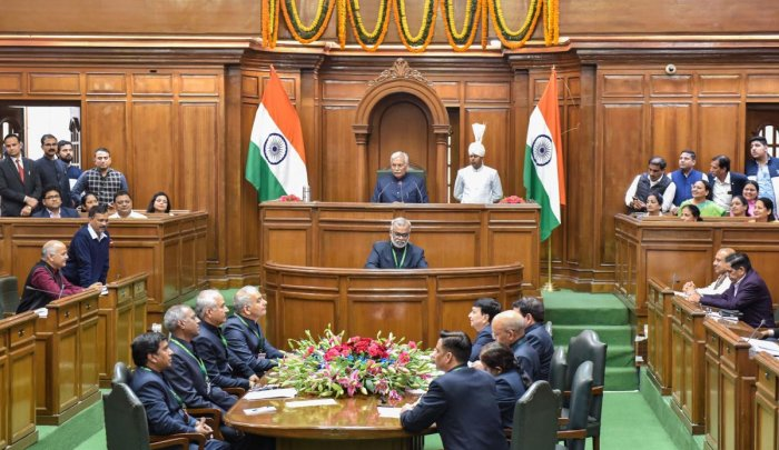 Delhi Chief Minister Arvind Kejriwal speaks as Delhi Deputy CM Manish Sisodia looks on during the first day of the three-day Delhi Assembly session, in New Delhi, Monday, Feb. 24, 2020. This is the first Assembly session after the Aam Aadmi Party (AAP) formed the government for the third time. (PTI Photo)