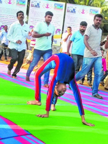 Tanushree Pithrody, 10, in action during 100-metre 'Chakrasana' race at Udyavara.