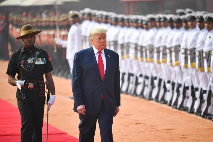 U.S. President Donald Trump inspects honour guards during the ceremonial reception at the forecourt of Rashtrapati Bhavan in New Delhi. (Reuters photo)
