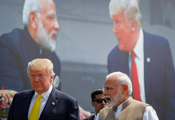 US President Donald Trump and Indian Prime Minister Narendra Modi speak during the welcoming ceremony, as Trump arrives at Sardar Vallabhbhai Patel International Airport in Ahmedabad