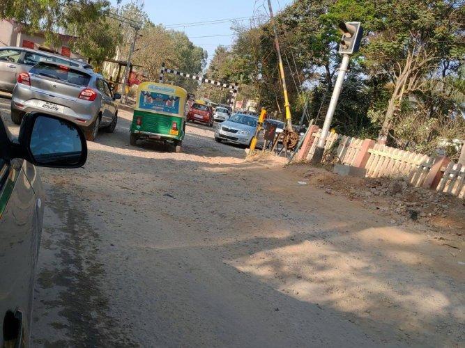 The railway level crossing at Carmelaram Main Road.Special arrangement