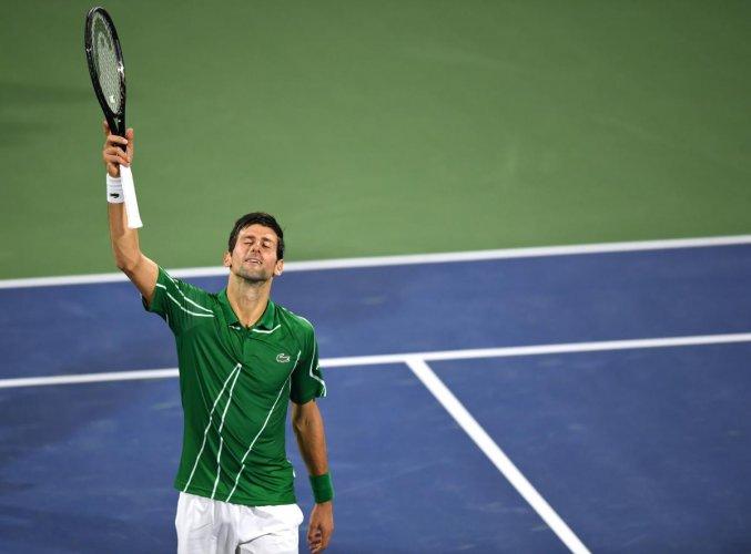 Serbia's Novak Djokovic celebrates after defeating to Tunisia's Malek Jaziri during round 1 of the Dubai Duty Free Tennis Championships in the United Arab Emirates