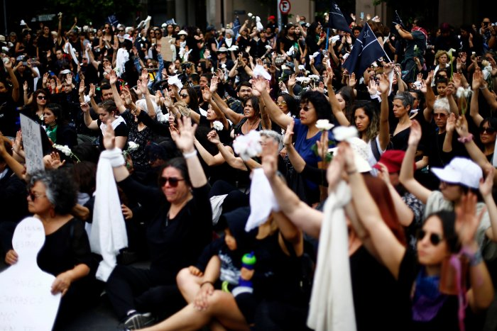People participate in a demonstration to pay tribute to people killed during the protests against Chile's government, in Santiago, Chile. (Reuters Photo)