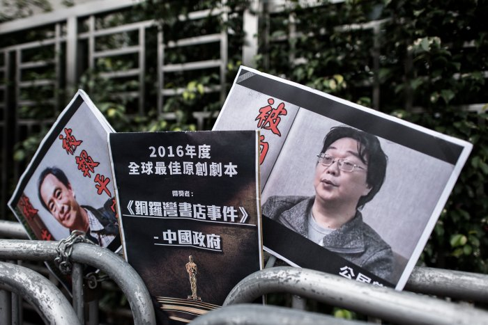 Placards showing missing bookseller Lee Bo (L) and his associate Gui Minhai (R) are seen left by members of the Civic party outside the China liaison office in Hong Kong. (Reuters Photo)