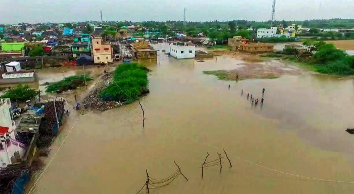 An aerial view of a flooded Rajpara village after heavy monsoon rainfall, in Gir-Somnath district on Wednesday. PTI Photo