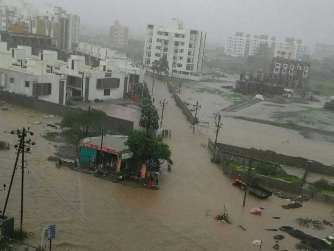 Ahmedabad, which remained relatively untouched by rain this season, received heavy downpour measuring over 4 inches in three hours post afternoon. The streets were waterlogged and life came to a standstill. (DH File Photo)