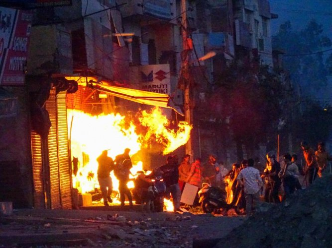 Delhi Police spokesperson Mandeep Singh Randhawa said the situation in northeast Delhi is under control, even as several parts of the area continued to reel under violence. Credit: PTI Photo