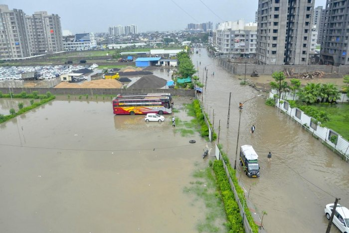 A flooded locality after heavy rain in Surat on Monday. PTI