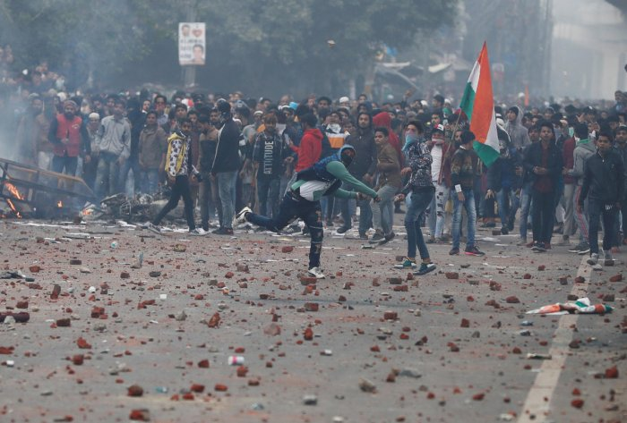 Demonstrators throw stones towards police during a protest against a new citizenship law in Delhi. (Representative Image/REUTERS Photo)