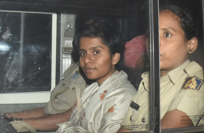 Police take activist Amulya back after producing her before a magistrate on Tuesday. DH PHOTO/JANARDHAN B K