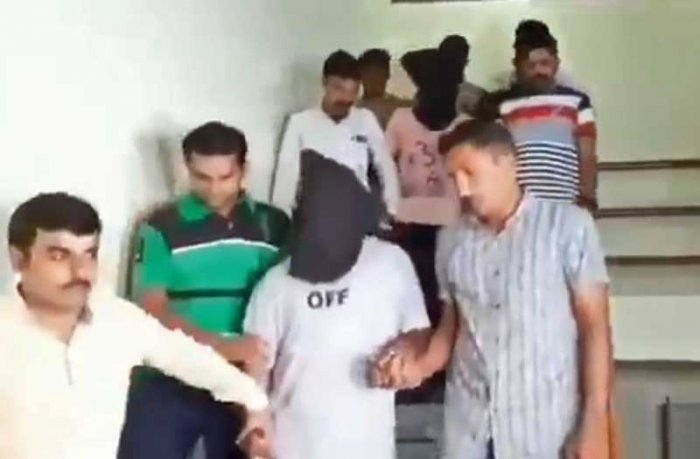 hey have been identified by ATS as Ashfaq J Shaikh(34)and Moinuddin K Pathan(27)were caught from Shamlaji on Gujarat-Rajasthan border.