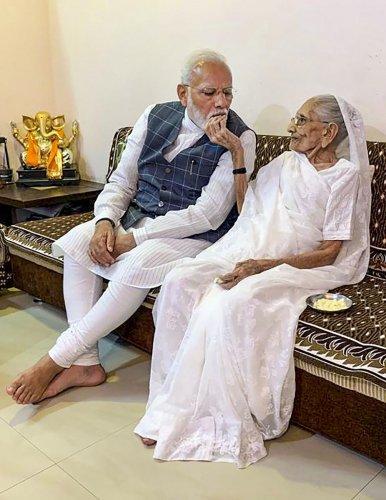 Prime Minister Narendra Modi meets his mother Heeraben Modi, in Gandhinagar, Wednesday, Oct. 30, 2019. (PTI Photo)