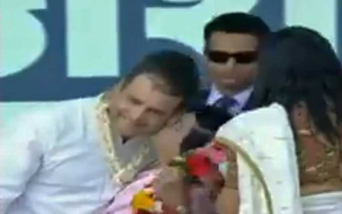 A screenshot from video, which shows Rahul is kissed by a woman worker.
