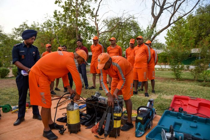 Personnel from India's 6th National Disaster Response Force (NDRF) check emergency and rescue material at an NDRF camp in Chiloda (also called Naroda), some 40 kms from Ahmedabad on June 11, 2019. (Photo: AFP)