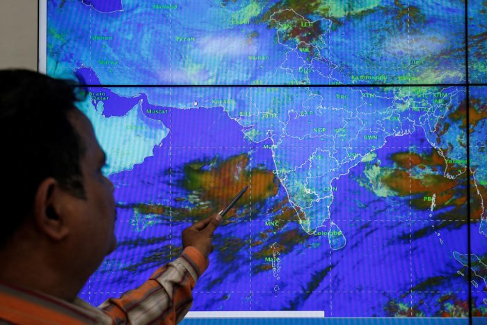 An India Meteorological Department scientist monitors Cyclone Vayu inside his office in Ahmedabad, India, June 11, 2019. REUTERS/Amit Dave