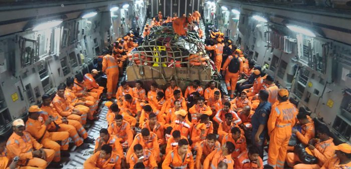 NDRF members seen inside the IAF C-17 aircraft as it lands at Jamnagar, in Gujarat, Wednesday, June 12, 2019. The NDRF team will carry out rescue and relief missions in Gujarat, for those affected by Cyclone Vayu. (PTI Photo)