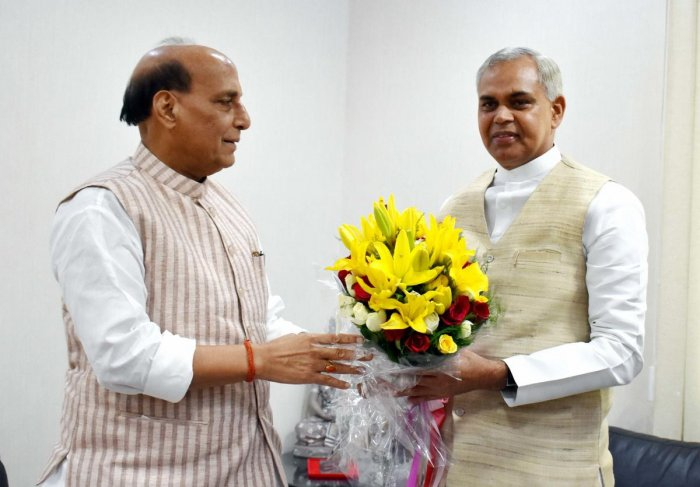 Defence Minister Rajnath Singh being greeted by designate Governor of Gujarat Acharya Devvrat during a meeting (PTI Photo)