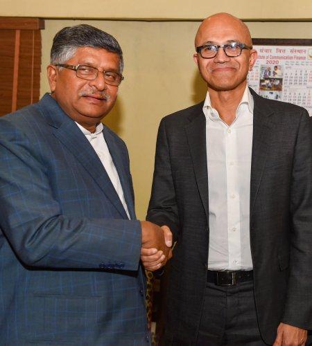 Communications and IT minister Ravi Shankar Prasad (L) shakes hands with Microsoft CEO Satya Nadella (C) during a meeting at Sanchar Bhawan, in New Delhi, Tuesday, Feb. 25, 2020. (PTI Photo