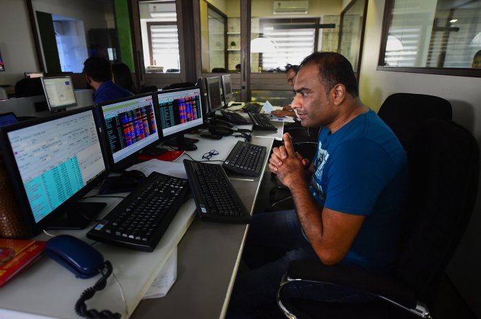 Traders monitor BSE index at a brokerage firm, as the Sensex goes down, in Mumbai. (PTI Photo)