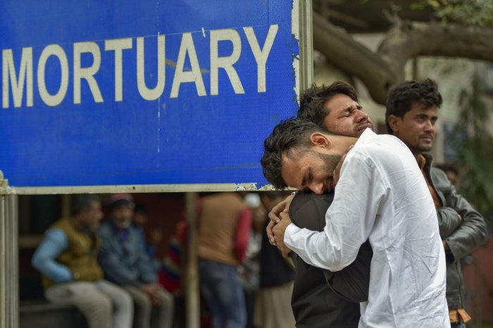 Kins of Mohsin Ali, who died in communal violence over the new citizenship law in northeast Delhi, cry after receiving his dead body outside the mortuary of GTB Hospital, in New Delhi, Thursday, Feb. 27, 2020. The death toll in the communal violence has reached 32 till today. (PTI Photo)