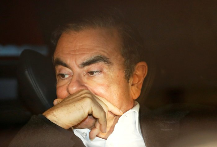 Former Nissan Motor Chairman Carlos Ghosn sits inside a car as he leaves his lawyer's office after being released on bail from Tokyo Detention House, in Tokyo, Japan. (Reuters Photo)