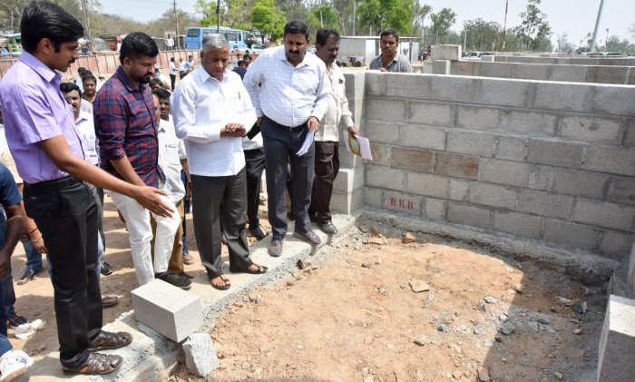 District In-charge Minister V Somanna inspects ongoing work atop the Chamundi Hill in Mysuru on Friday. Deputy Commissioner Abhiram G Sankar and MP Pratap Simha are seen. dh photo