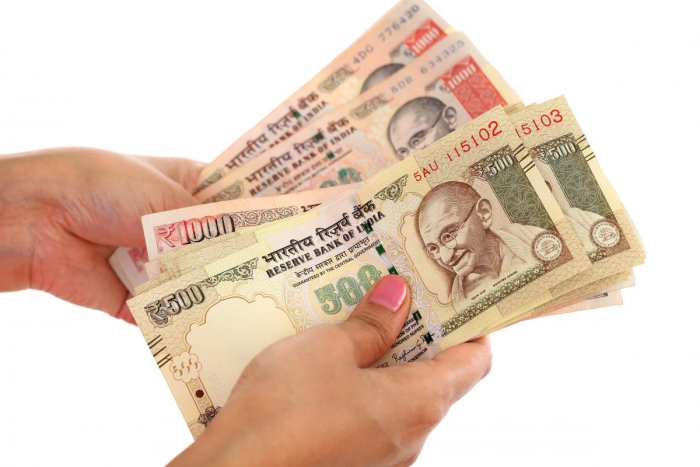 Closeup of woman hands counting money against white background Rupee.