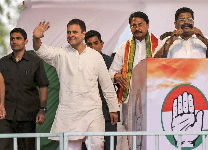 Congress President Rahul Gandhi waves to his supporters during an election campaign for the upcoming Lok Sabha polls, in Nagpur, Thursday, April 04, 2019 (PTI Photo)