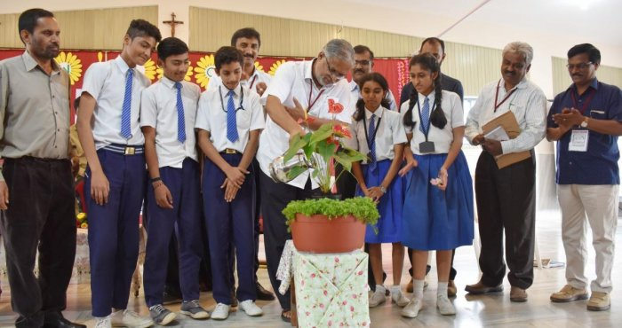 Minister for Primary and Secondary Education S Suresh Kumar inaugurates an interaction programme with students at St Joseph High School in Madikeri.