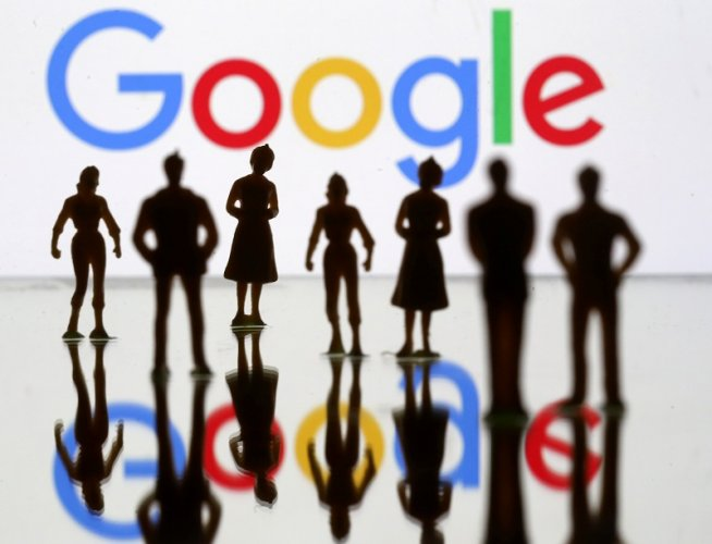 Small toy figures are seen in front of Google logo in this illustration. (Reuters Photo)