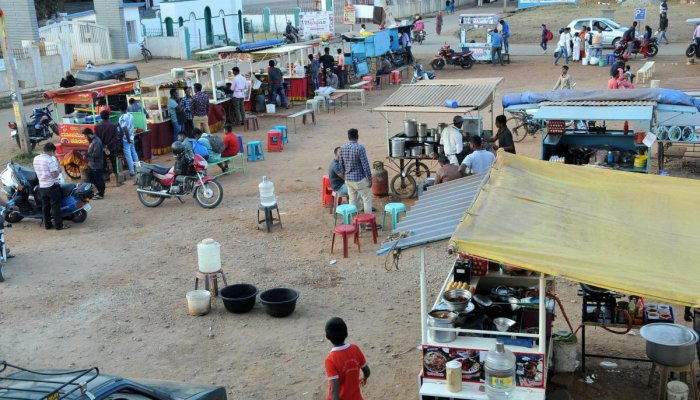 Pushcart vendors sell various items at Vijayanagara in Chikkamagaluru.