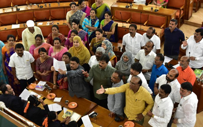 Opposition Congress leaders trooped into the well of the BBMP council on Saturday in protest against a BJP corporator's remarks on the mayor's powers to form committees. DH PHOTO/ IRSHAD MAHAMMAD