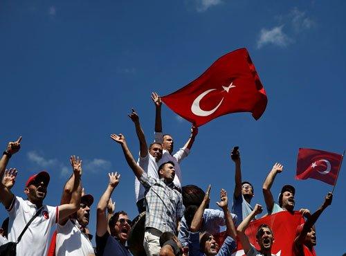 Turkey fires 24,000 teachers, police in coup plotters hunt