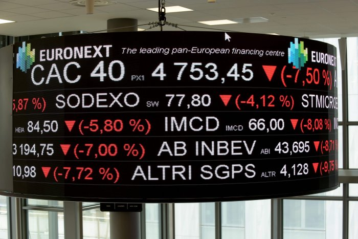 In Moscow, the market slumped badly at the opening Tuesday, losing more than 10 percent, playing catch up after it was closed Monday for a public holiday. (Credit: AFP Photo)