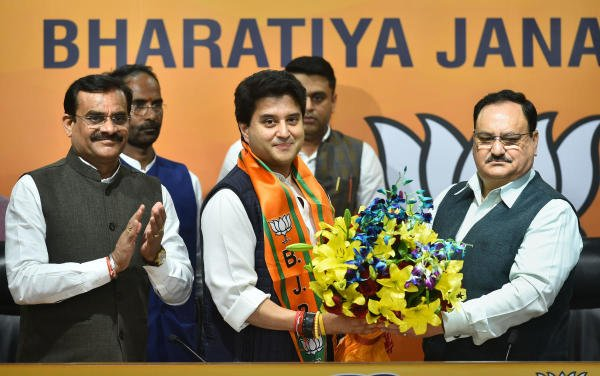 Former Congress leader Jyotiraditya Scindia (C) is welcomed as he joins Bharatiya Janata Party (BJP) in presence of BJP President JP Nadda (R), at BJP headquarters in New Delhi, Wednesday, March 11 , 2020. Also seen is BJP Madhya Pradesh state president Vishnu Dutt Sharma (L). (PTI Photo/Arun Sharma)