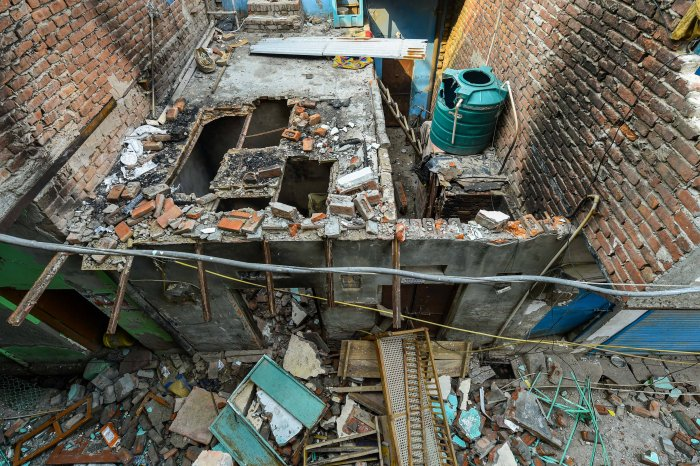 A view of the backside of the Madina mosque, damaged during the recent communal violence, at Shiv Vihar in Northeast Delhi. (Credit: PTI)