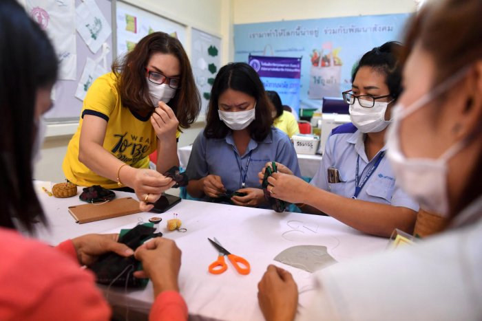 Women take part in a workshop to learn how to make face masks to protect against coronavirus in Bangkok, Thailand. (Reuters photo)
