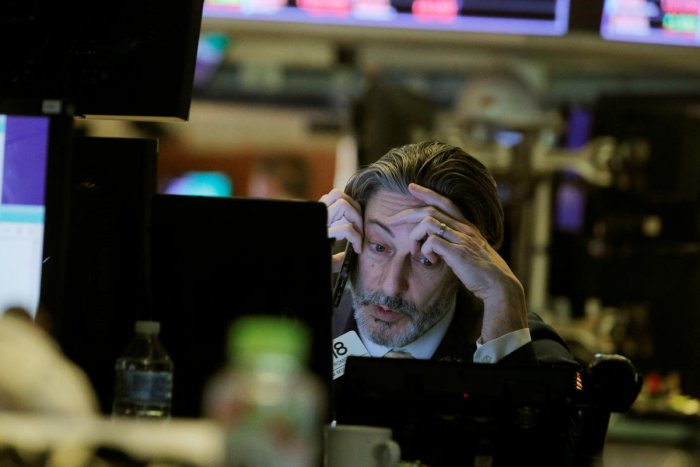 A trader talks on the phone while working on the floor of the New York Stock Exchange (NYSE) in New York. Reuters