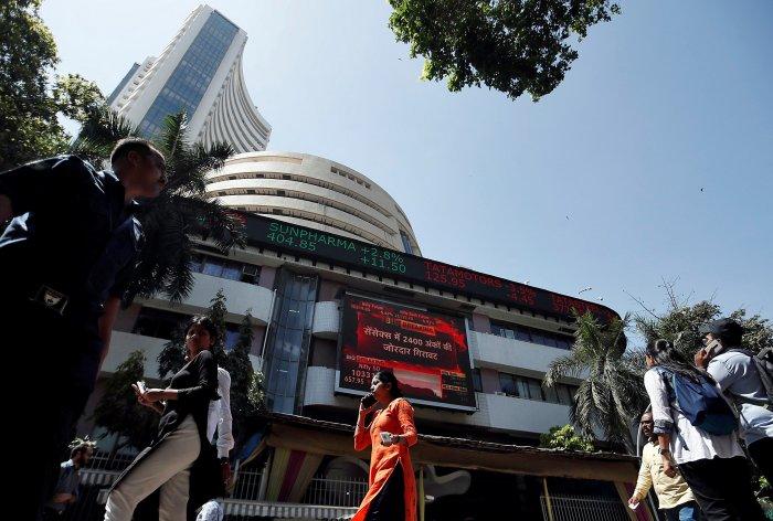 People walk past the Bombay Stock Exchange (BSE) building in Mumbai. (Credit: Reuters)